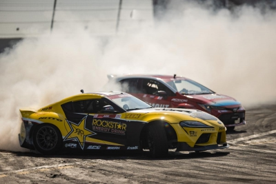 Papadakis Racing drivers Fredric Aasbo (2020 Rockstar Energy Drink Toyota GR Supra) and Ryan Tuerck (the Gumout / Nitto Tire / Toyota Corolla) tandem drift at an Irwindale Speedway team test earlier this year.