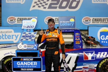 Chase Elliott earns $100K for virus relief with Gander Trucks win over Kyle Busch